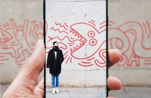 Man stood in front of graffiti with AR feature