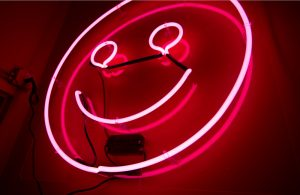 Smiling face neon sign