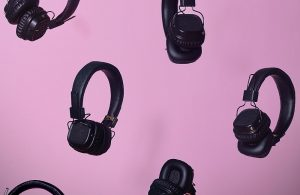 Headphone sets on a pink background
