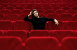 Lady looking bored in a cinema